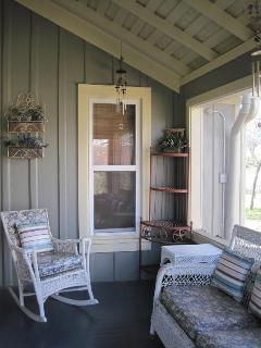 Screened porch off of the kitchen, great for relaxing