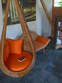 A tranquil place to read a good book. Rattan swing chair over-looking rice fields