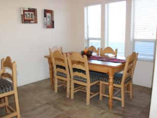 There is room for the whole family to eat together with 6 seats at the table and 4 at the counter.