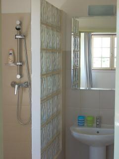 En-suite bathroom to the second bedroom with walk-in shower. Shower gel and soap are also provided