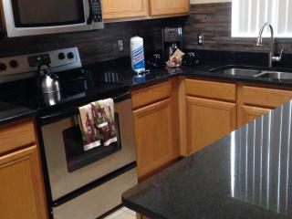 fully equipped kitchen , with granite just changed to black