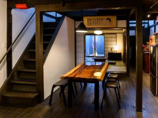 Entering the house you will discover the beautiful 'Tsuboniwa Zen Garden', past the dining area.