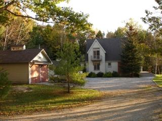 View of cottage as you arrive through the woods