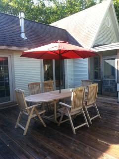 Teak dining table on deck & screen porch