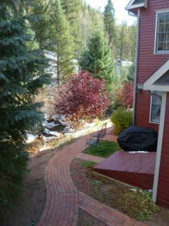 lined with a brick path situated by a soothing creek