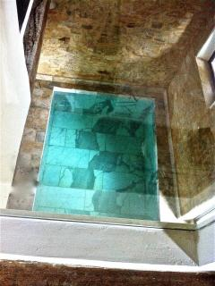 View from the first floor bathroom to the ground floor pool