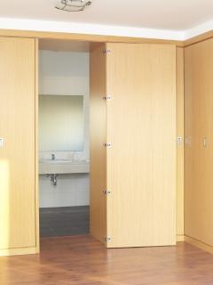 Master bedroom - plenty of wardrobe space with entry through wardrobe door into en-suite