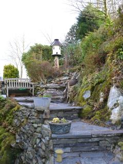 Steps up from the cottage to the top of the garden where views of Snowdon can be seen