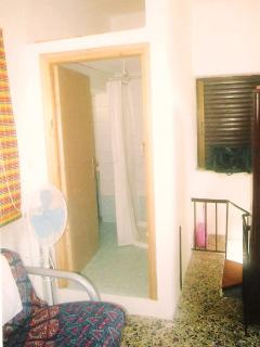 small bedroom upstairs leading to shower room and toilet