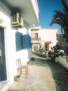 terrrace space outside the house with blue shutters, space for outside table, chairs