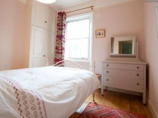 Master bedroom with freshly laundered sheets and plenty of room to hang your clothes.