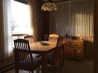 Dining area seats six comfortably...outdoor patio dining available  with large table, umbrella