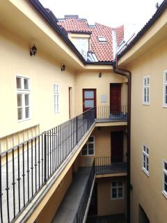 The building and the door of the apartment