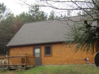 Enjoy a beautiful 10'x20' deck overlooking the pine forest.