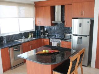 Fully equipped kitchen with granite counters.