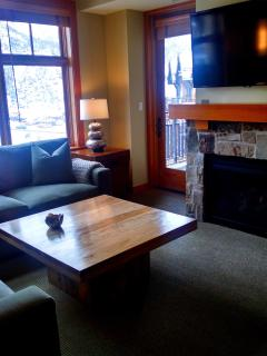 Living Room with gas fireplace and 55' Hi Def Samsung TV