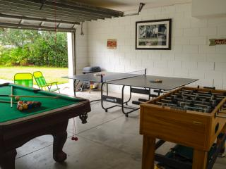 Games area with full size pool table, table tennis, and foosball