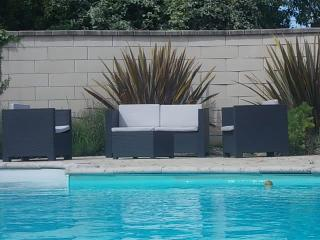 Heated swimming pool..a real sun trap and fenced off for safety