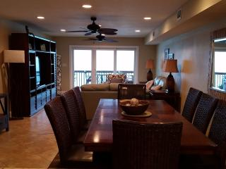 View from kitchen to dining and living room. Large table with seating for 8 + 2 at the bar.