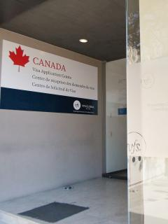 We are located right around the corner from the new Canadian Visa Center. An in-out process!