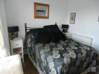 The double bedded room has TV, wardrobe, chest of drawers and en-suite shower room
