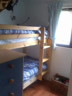 2nd bedroom equipped with a bunk bed.