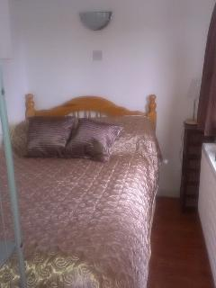 Bedroom 1 equipped with double bed
