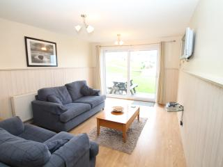 LARGE LOUNGE AREA,    with LCD tv,   dvd and freeview.   Patio doors lead to communal gardens + pool
