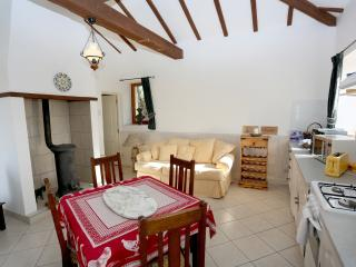 Spacious living area with modern Kitchen facilities. Flat screen Tv. Coffee machine