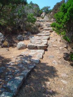 granite steps from the villa to the small secluded beach