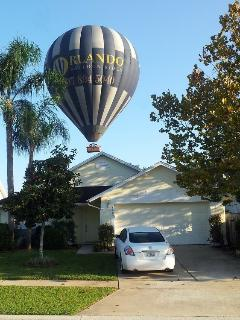 You never know who might drop in! Hot air balloons often fly over our home. This one came very close