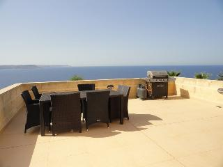 Terrace with BBQ and views over the Mediterranean sea.