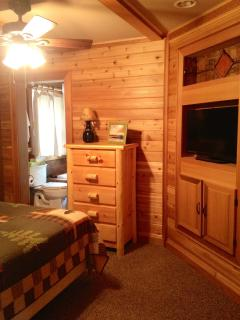 master bed (queen) and flatscreen TV and bath with jetted tub/shower and flatscreen TV