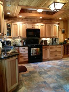 fully equipped kitchen with all new appliances and granite counter tops