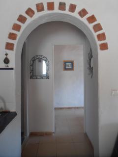 moorish arch through to bedroom and bathroom