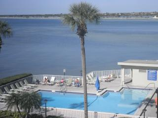 A Large Heated swimming pool and great waterfront views from your Balcony, Living room and Kitchen.
