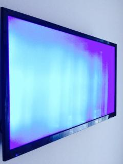 Wall mounted TV in both sitting room & bedroom