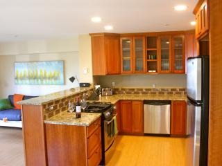 Fully stocked kitchen with granite countertops and enough cupboard space to call this home for quite