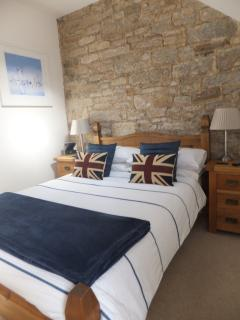Rear bedroom with double bed and en-suite shower room