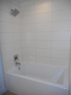 Deep bathtub with rain shower head
