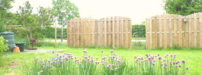 The partly fenced garden offers great privacy