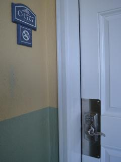 Condo entrance door with combination lock