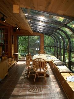 The sunroom overlooks the Birch Creek