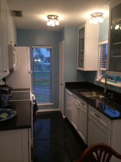 The kitchen is recently updated. Neat, tidy and efficient -- and it even has a view!