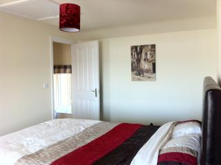 Master bedroom - with a comfortable bed, wash hand basin, fitted wardrobes and a wonderful sea view