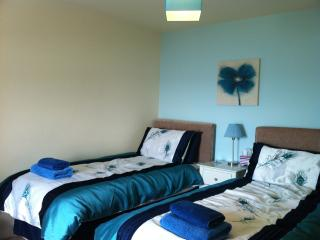 Twin bedroom - has a wardrobe, bedside chests and a lovely sea view