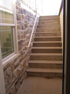 View of stairway to the lower guest suite. May not be suitable for all guests.
