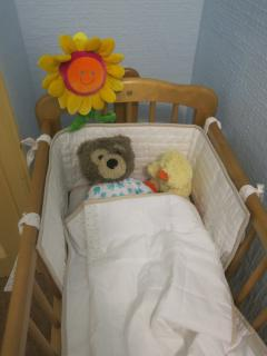 The cot is kept in the kids' bedroom but is small enough to be moved around as required