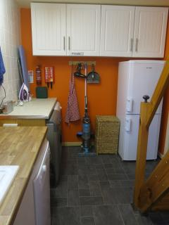The utility area has dishwasher, washing machine, tumble drier and fridge-freezer