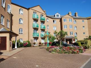 Spacious second floor apartment with elevator, balconies, water views & parking!